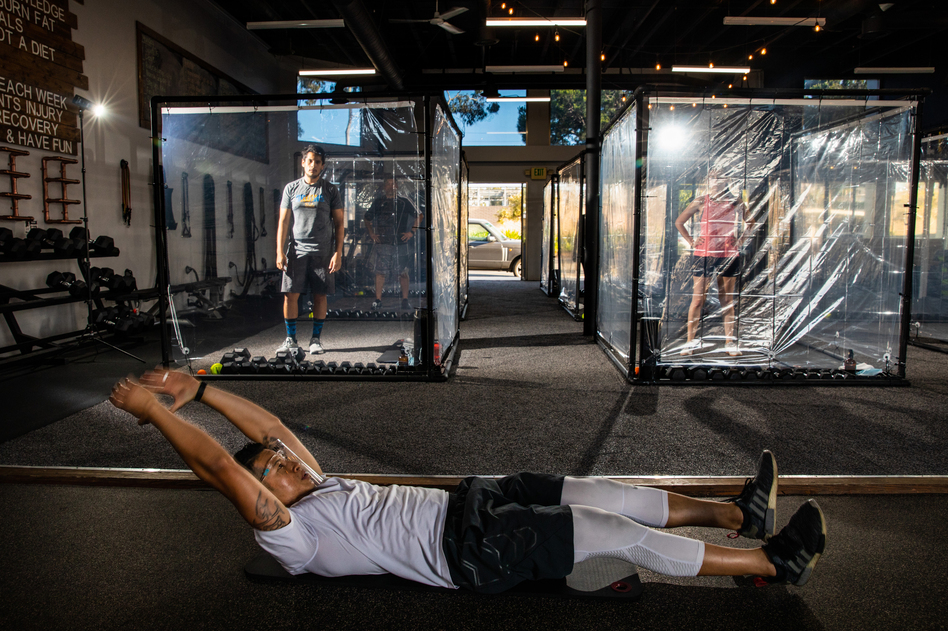"Peet Sapsin directs clients inside custom built ""Gainz Pods"", during his HIIT class, (high intensity interval training), at Sapsins Inspire South Bay Fitness, Redondo Beach, California, Wednesday, June 17, 2020. (Jay L. Clendenin/Los Angeles Times via Getty Images)"