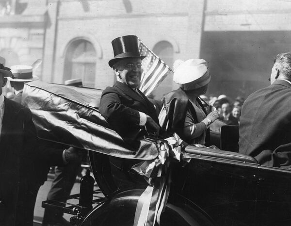President Woodrow Wilson and first lady Edith Wilson ride in a carriage in New York.