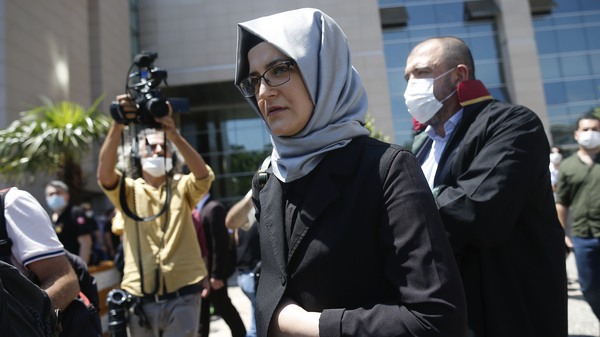Hatice Cengiz, who was engaged to slain Saudi journalist Jamal Kashoggi, leaves a court in Istanbul on Friday. Two former aides to Saudi Crown Prince Mohammed bin Salman and 18 other Saudi nationals are on trial in absentia over the 2018 killing of the Washington Post columnist.