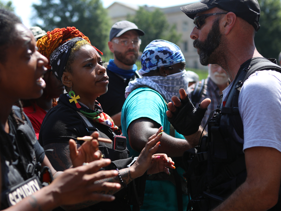 Armed Black protesters exchange words with a far-right activist during a gun rights rally put on by members of the Boogaloo movement in Richmond, Va. (Jim Urquhart for NPR)