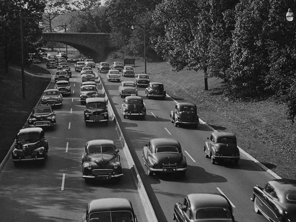 Cars on the Southern State Parkway in Nassau County, circa 1960. The urban planner Robert Moses, according to biographers, designed the road so that bridges were low enough to keep buses — which would likely be carrying poor minorities — from passing underneath on the route from New York City to Long Island's beaches. (Pictorial Parade/Getty Images)