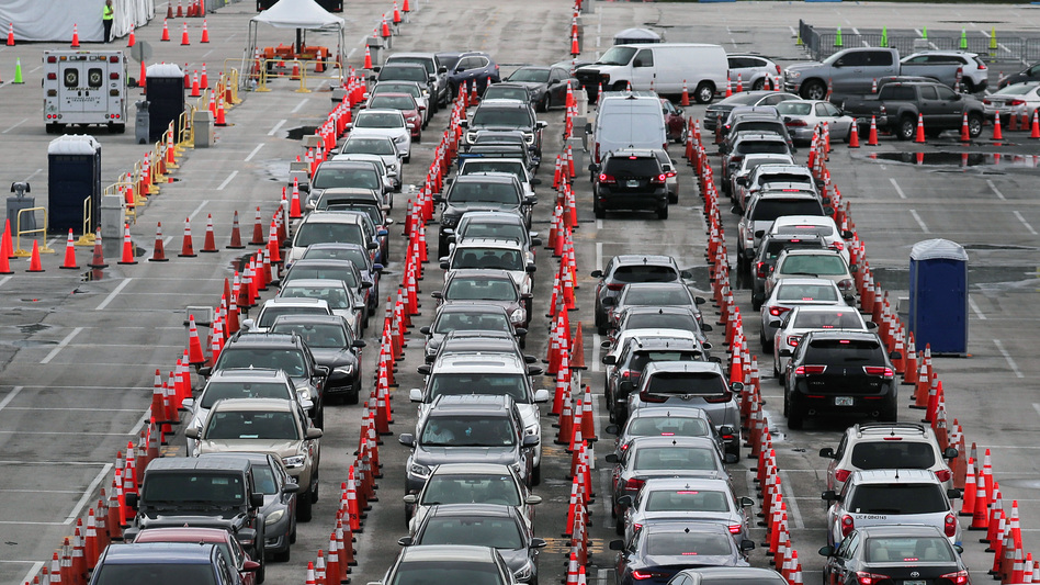 Lines and lines of cars are seen as drivers wait on Monday to be tested for COVID-19 at a coronavirus testing site in Miami Gardens, Fla. (Joe Raedle/Getty Images)
