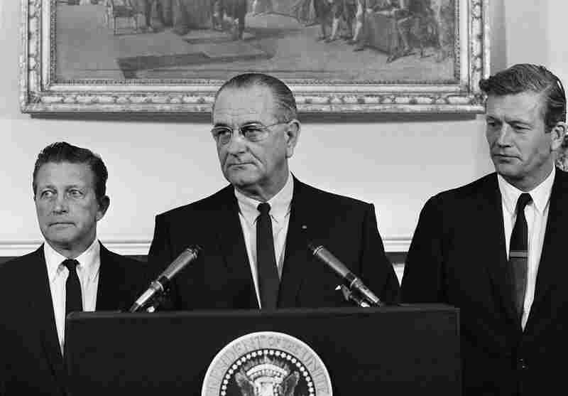 President Lyndon Johnson speaks to the Kerner Commission at the group's first meeting at the White House on July 29, 1967. Otto Kerner, left, of Illinois, the chairman of the group and Mayor John Lindsay of New York (right) vice chairman.