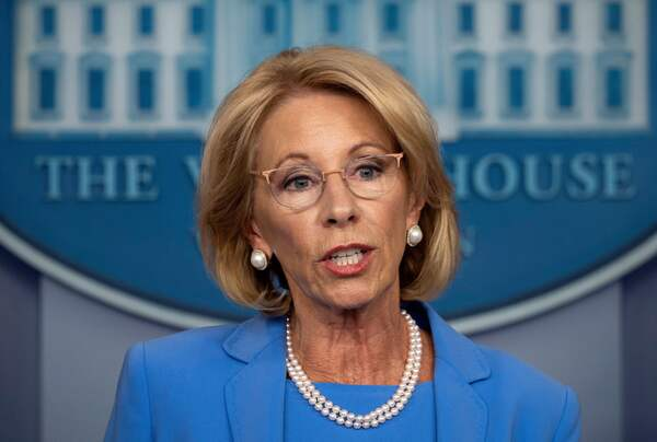 Education Secretary Betsy DeVos, seen here during a White House briefing in March, will participate in a panel discussion Tuesday on how to reopen America's schools safely.