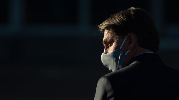 Brazilian President Jair Bolsonaro, seen during a ceremony last month in Brasilia, has announced his coronavirus test results.