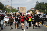 Black Students Matter demonstrators march en route to a rally at the Department of Education in Washington, D.C., on June 19.