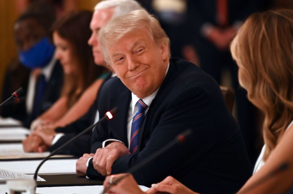 President Trump, seen here at a roundtable discussion at the White House on Tuesday, rebuked the CDC for its guidelines on reopening schools in a tweet Wednesday. (Jim Watson/AFP via Getty Images)