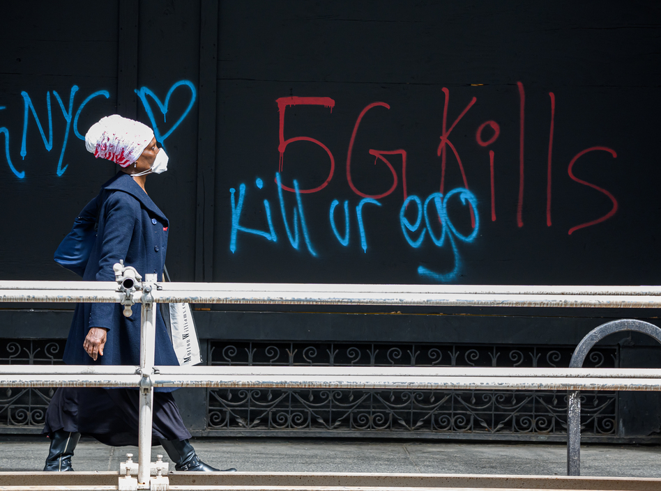 A pedestrian walks past anti-5G graffiti in the Flatiron District of New York in May. (Noam Galai/Getty Images)