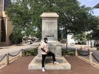 """Protest organizer DAntjuan Miller stands by the granite pedestal that remains of a monument to Confederate Navy Adm. Raphael Semmes in Mobile, Ala. """"It's like a weight that's lifted off now that it's gone,"""" he says."""