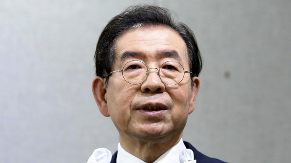 Police say that Seoul Mayor Park Won-soon, shown during a press conference earlier this month, was found dead in a wooded park. A police official says the cause of death is under investigation.