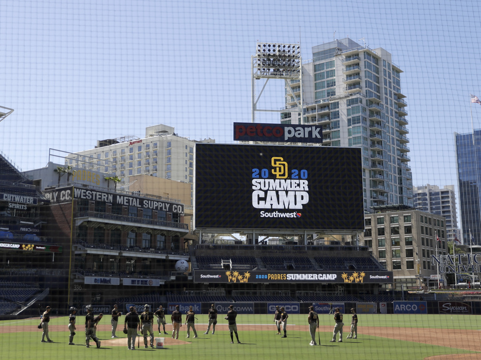 Members of the San Diego Padres meet in the infield during baseball training last week at Petco Park in San Diego. Major League Baseball is taking steps to start the 2020 season amid the coronavirus pandemic. (Gregory Bull/AP)