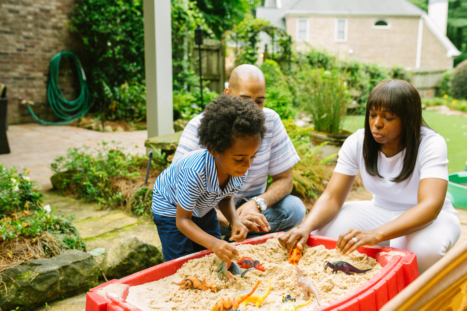 Spending quality time with kids and listening deeply to them is one way to help them tame anxiety. Here Mariano Noesi and Maryam Jernigan-Noesi play with their 4-year-old son Carter.  Jernigan-Noesi is a child psychologist. (Lynsey Weatherspoon for NPR)