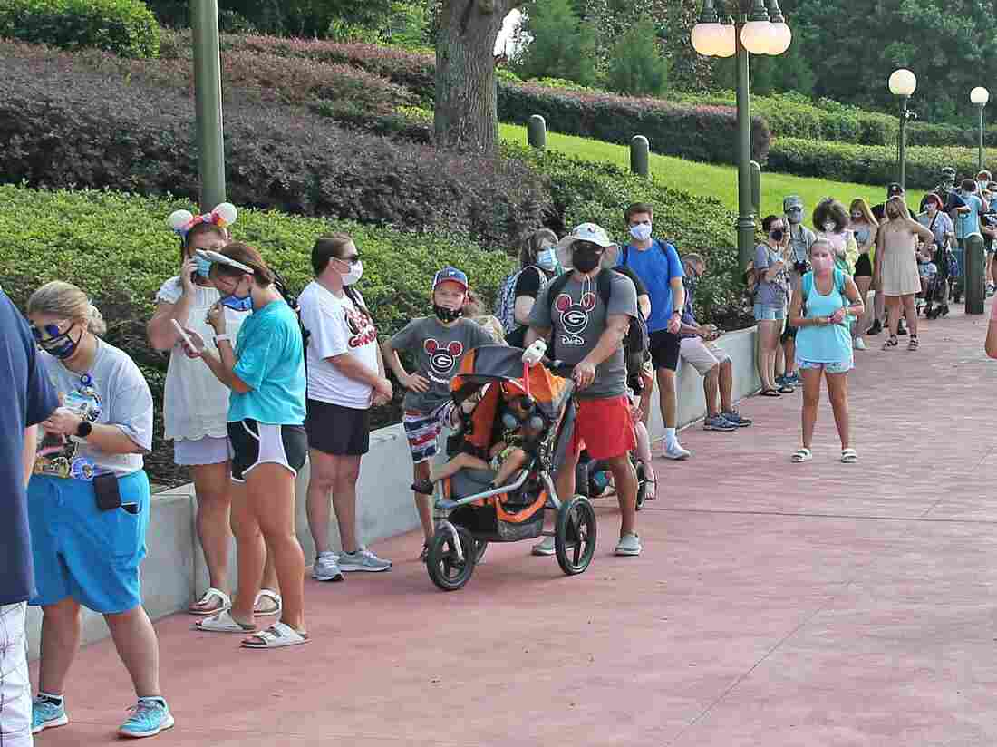 Masks And Mouse Ears: Disney World Reopens As Coronavirus Cases Climb In Florida 2