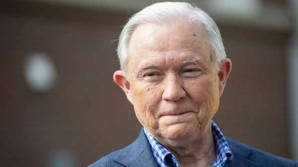 Jeff Sessions talks with the media after voting in Alabama
