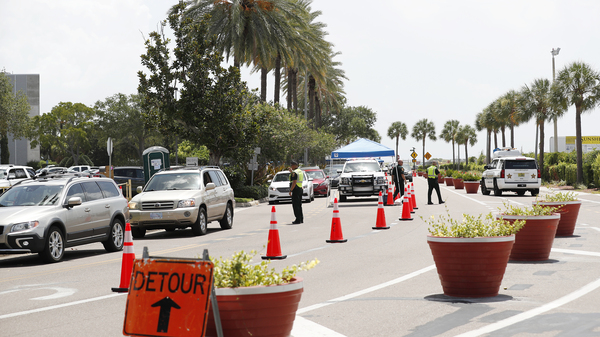 Cars line up for drive-through coronavirus testing in St. Petersburg, Florida. The state reported a record-breaking 15,299 new cases on Sunday.