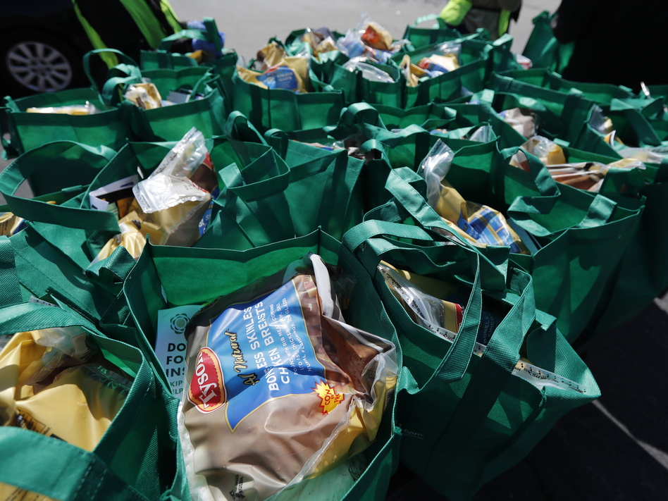 Bags of fresh food wait to be given away in Chicago in May. The number of malnourished people is expected to climb globally, according to the United Nations. (Charles Rex Arbogast/AP)
