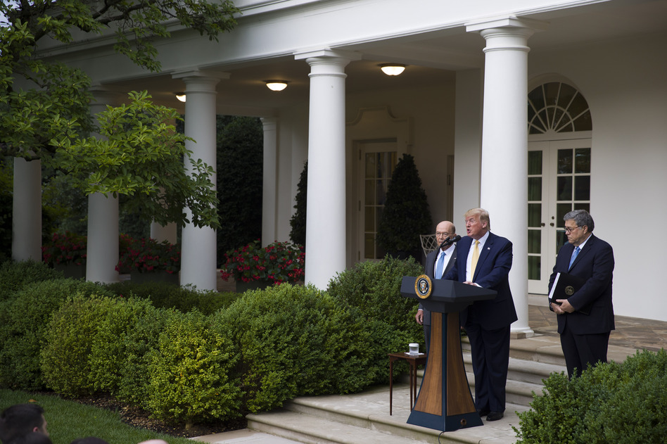 Iowa, Nebraska, South Carolina and South Dakota have agreed to share their state driver's license and state ID records with the U.S. Census Bureau as part of efforts to carry out an executive order for citizenship data that President Trump announced in July 2019 with Commerce Secretary Wilbur Ross (left) and U.S. Attorney General William Barr in the White House Rose Garden. (Alex Brandon/AP)