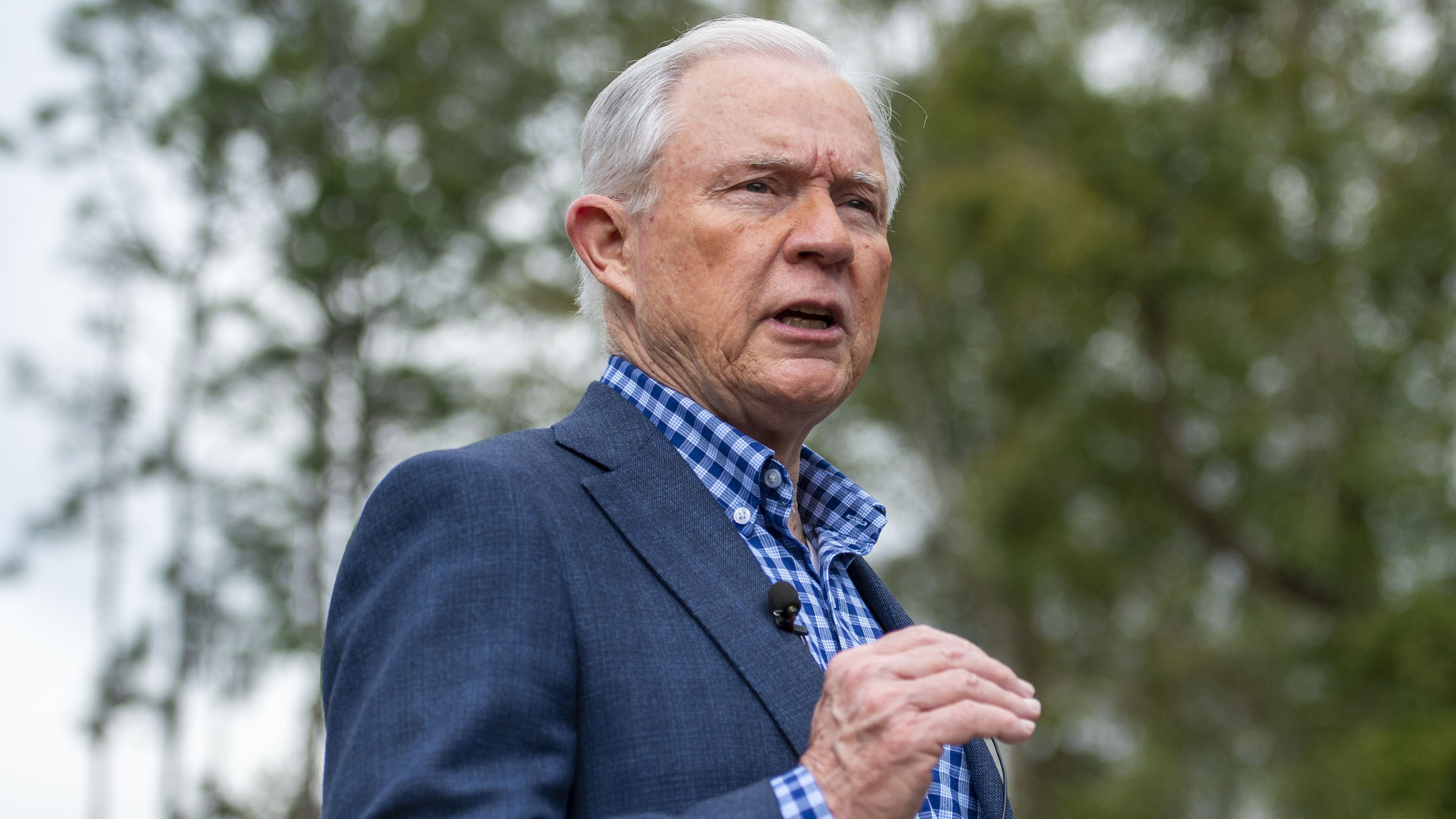 Jeff Sessions talks with the media after voting in Alabama's primary election, on March 3 in Mobile, Ala.