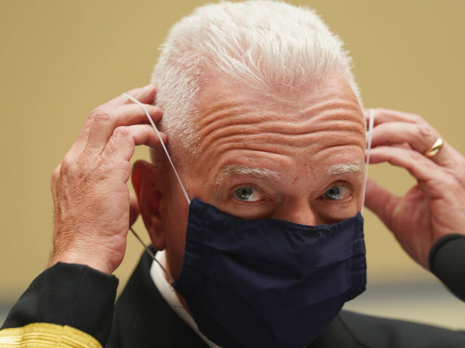 Adm. Brett Giroir, assistant secretary for health in the Department of Health and Human Services, adjusts his face mask while testifying this month before a House subcommittee on the coronavirus crisis. (Kevin Lamarque/Pool/Getty Images)