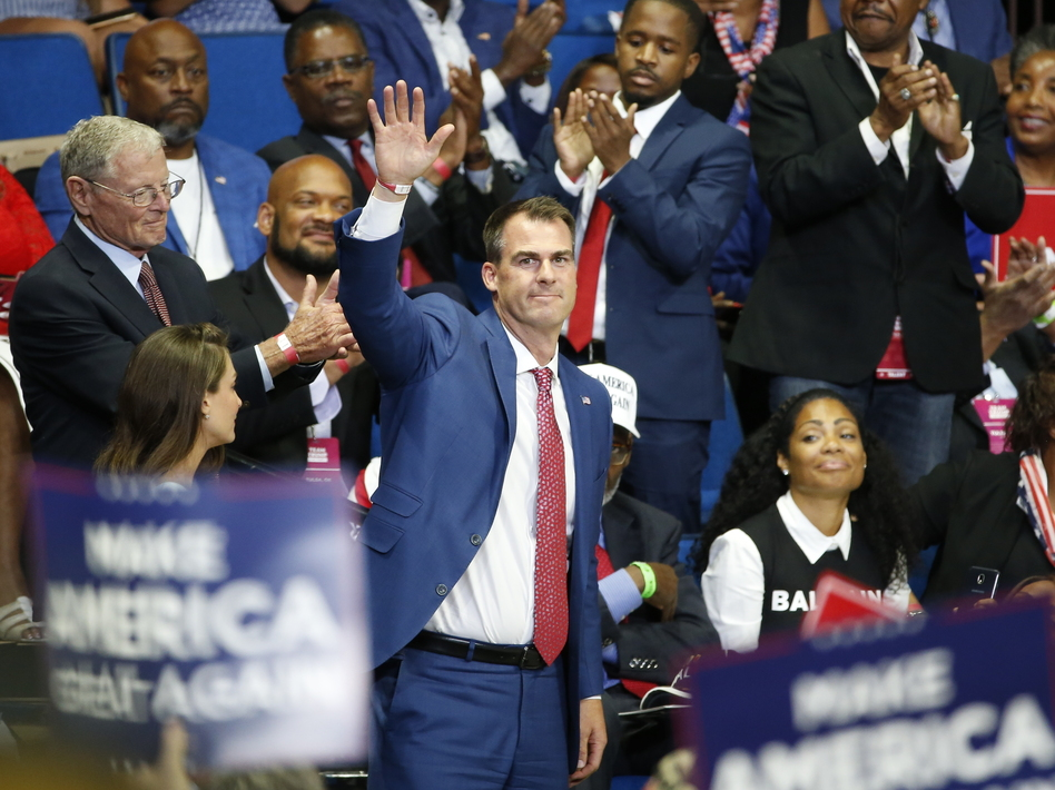 Oklahoma Gov. Kevin Stitt attends President Trump's campaign rally last month in Tulsa. Stitt dismisses the notion that he became infected at the June 20 event, saying it was too long ago. (Sue Ogrocki/AP)