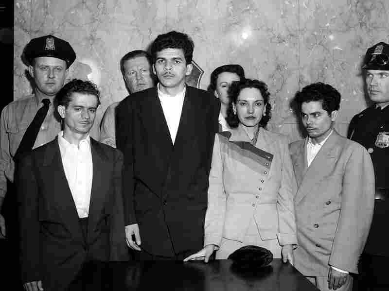 Puerto Rican nationalists Irvin Flores Rodriguez, Rafael Cancel Miranda, Lolita Lebron, and Andres Figueroa Cordero, standing in a police lineup following their arrest after a shooting attack on the U.S. Capitol, March 1, 1954.