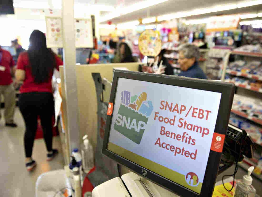 """SNAP/EBT Food Stamp Benefits Accepted"" is displayed on a screen inside a Family Dollar Stores Inc. store in Chicago, Illinois, U.S., on Tuesday, March 3, 2020."