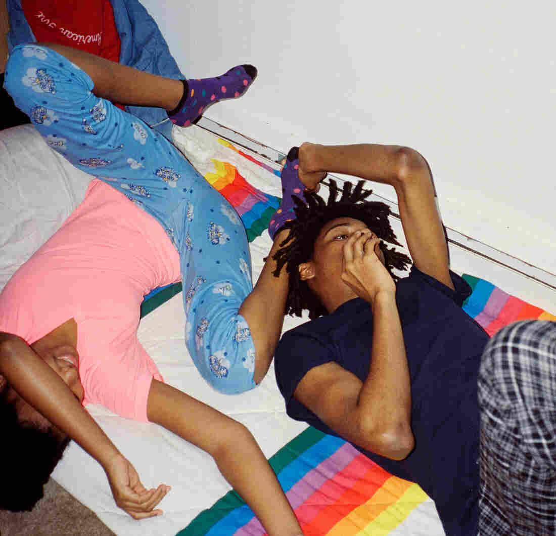 Thandi and Khaya lying down in their pajamas.