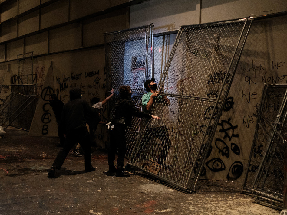 Protesters attempt to barricade the entrance to the U.S. District Court building on July 17 in Portland, Oregon. (Mason Trinca/Getty Images)