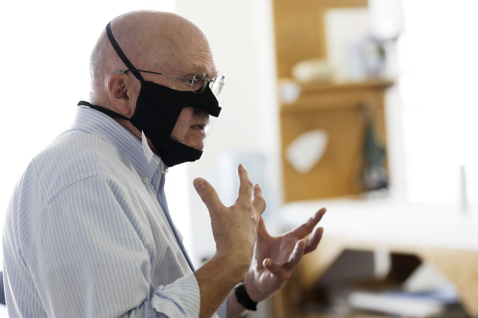 Michael Conley, who is deaf, models a mask that has a transparent panel in San Diego on June 3. Face coverings can make communication harder for people who rely on reading lips, and that has spurred a slew of startups and volunteers to make masks with plastic windows. (Gregory Bull/AP)