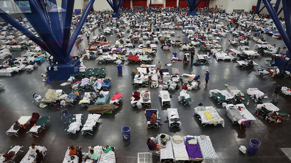 In August 2017, the George R. Brown Convention Center in Houston was over capacity after floodwaters from Hurricane Harvey inundated the city. This hurricane season, congregate shelters — from school gyms to vast convention centers — risk becoming infection hot spots if evacuees pack into them as they have in the past.