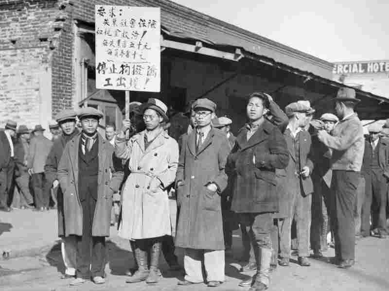 1933: Unemployed demonstrators in the hunger parade present demands to the state Legislature in Sacramento, Calif. The sign being held calls for $50 a month in unemployment insurance with $10 for each dependent and other demands.