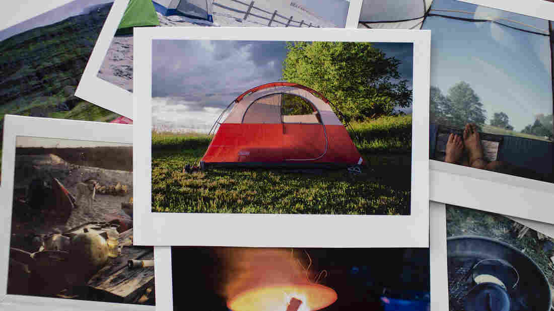 A photo of a pile of polaroid pictures depicting different scenes from camping — a red tent in the center of the pile.