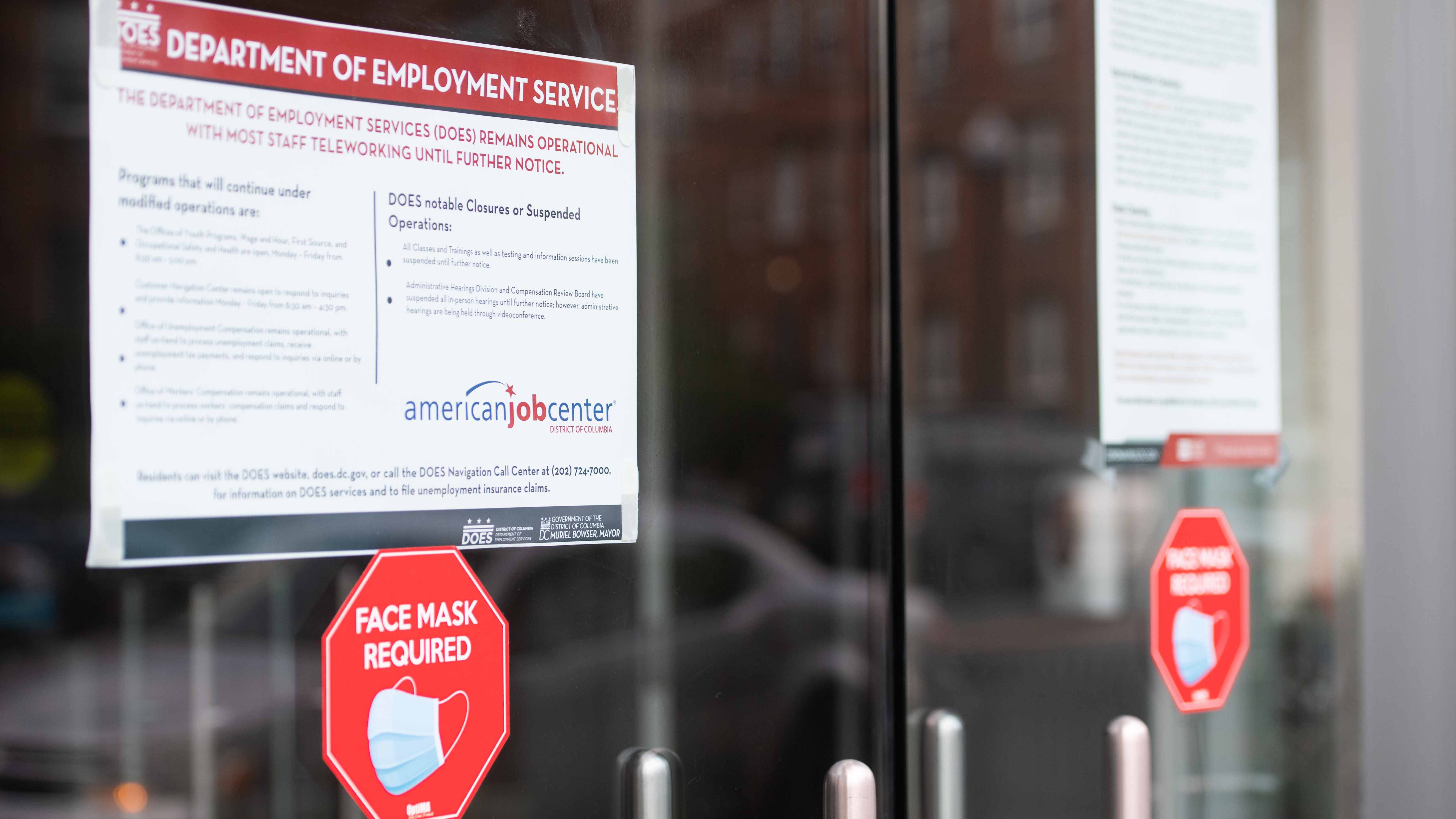 Signs are displayed outside the Washington, D.C., Department of Employment Services. New claims for unemployment benefits around the country rose for the first time in four months.