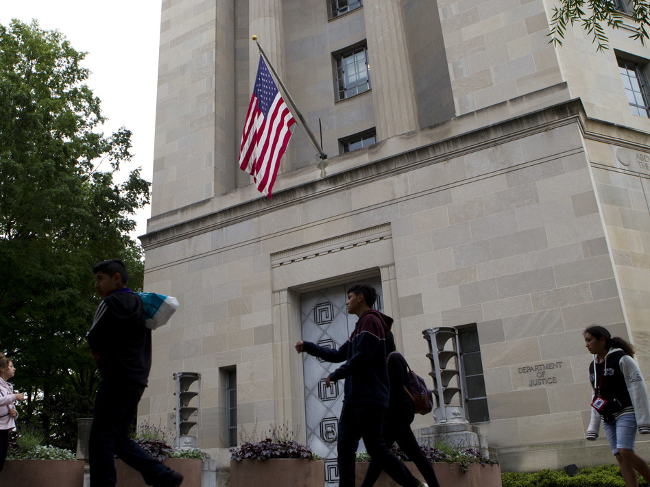 The Department of Justice is marking 150 years this month and some former employees and officials say the time has come for reforms in its relationship with the White House. (Jose Luis Magana/AP)