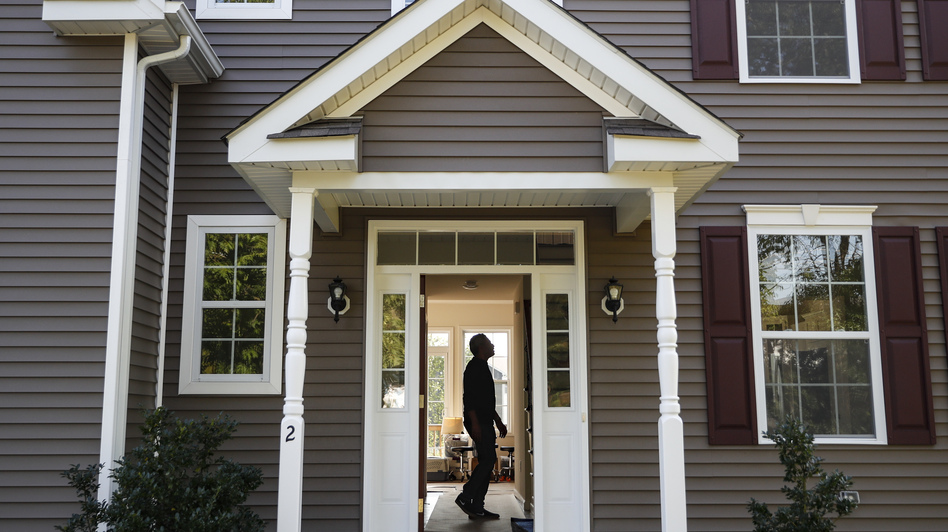 A new homeowner tours his new place in Washingtonville, N.Y., this month. (John Minchillo/AP)