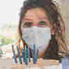 Coronavirus FAQ: What Does It Mean If I Can Blow Out A Candle While Wearing A Mask?