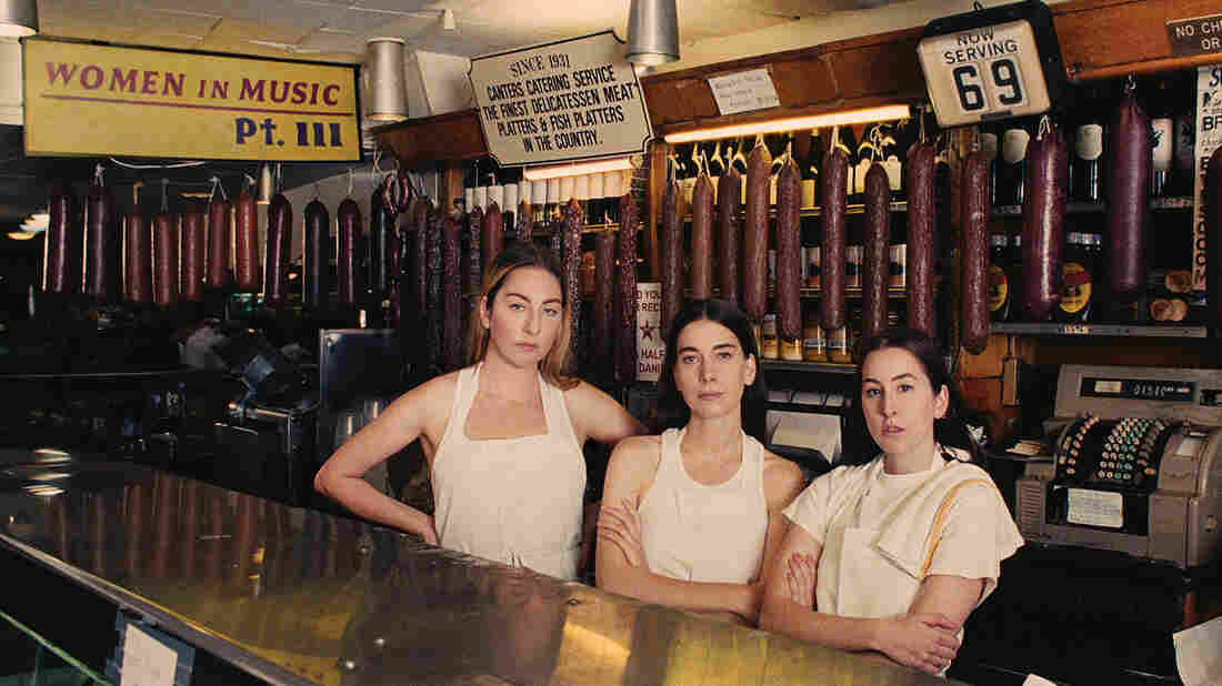 Sisters Este, Danielle, and Alana Haim of the band HAIM join Ask Me Another.