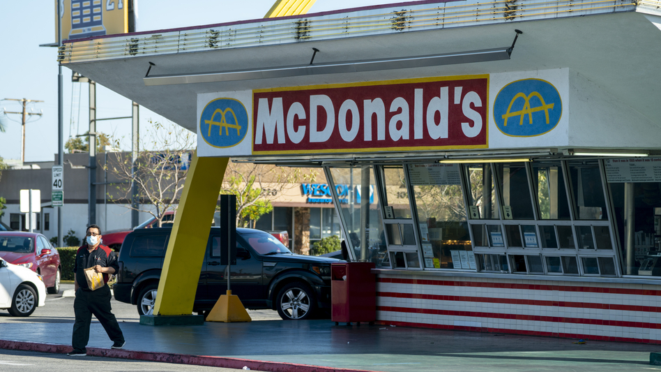 McDonald's will require all customers at its U.S. restaurants to wear a face mask, starting Aug. 1, the company says. Here, a customer wears a mask at the oldest operating McDonald's Corp. restaurant, in Downey, Calif., in April. (Kyle Grillot/Bloomberg via Getty Images)