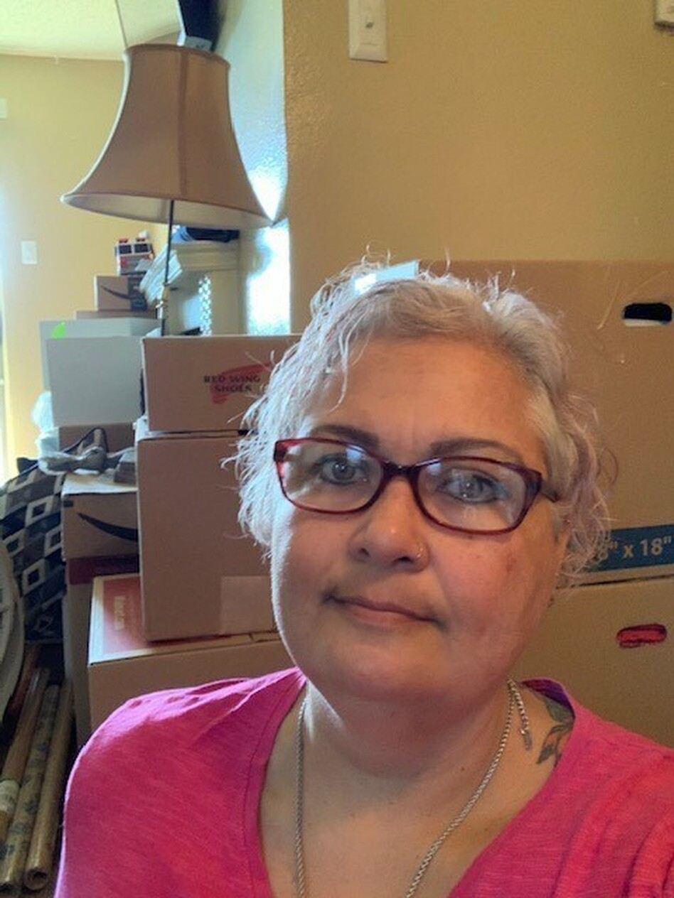 """Merry Collins has been fighting COVID-19 and the threat of eviction at the same time. She's been boxing up her belongings in her Dallas apartment and worries she could be evicted soon. """"I'm scared,"""" she says. (Merry Collins)"""