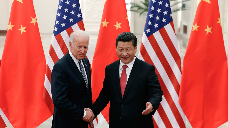 """Then-Vice President Joe Biden shakes hands with Chinese President Xi Jinping in Beijing on Dec. 4, 2013. """"I've traveled 17,000 miles with him,"""" Biden told attendees at a campaign rally in Nevada earlier this year. (Lintao Zhang/AFP via Getty Images)"""