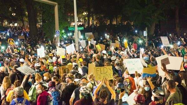 Protests in Portland, shown here on July 24, have grown increasingly heated with the presence of federal agents. On Monday, groups and individual protesters sued the federal government over its response.
