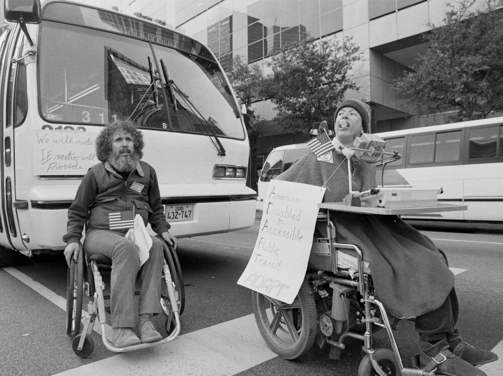 Members of ADAPT demonstrate to get city buses with lifts.