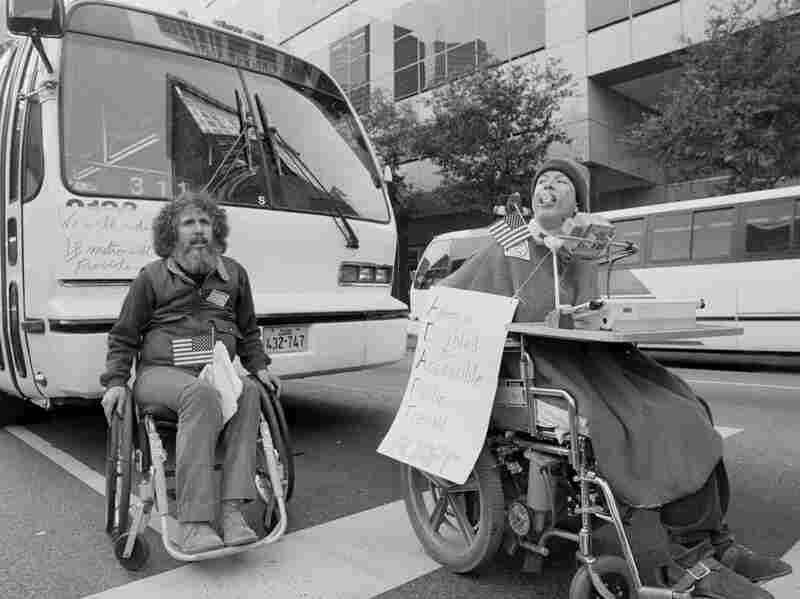 Bob Kafka and Shirley Kopecky, members of ADAPT (Americans Disabled for Accessible Public Transit), demonstrate in downtown Houston in an effort to get the city to buy buses with lifts to load people with disabilities.