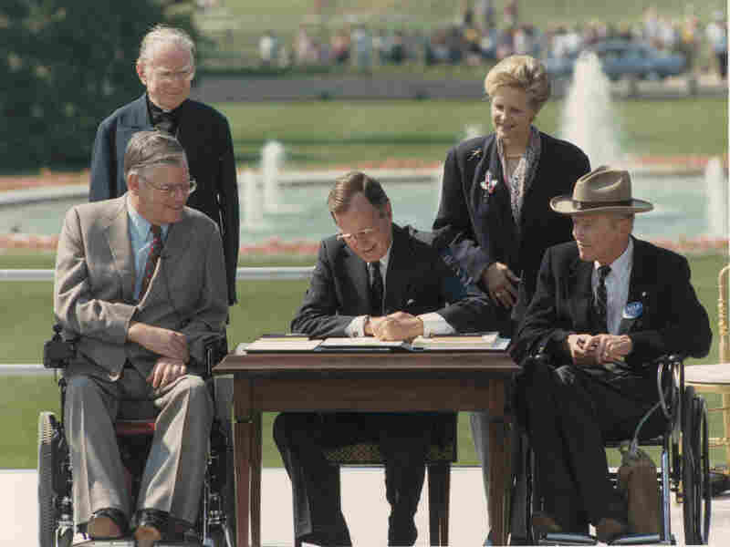 President George Bush signs the Americans with Disabilities Act of 1990.