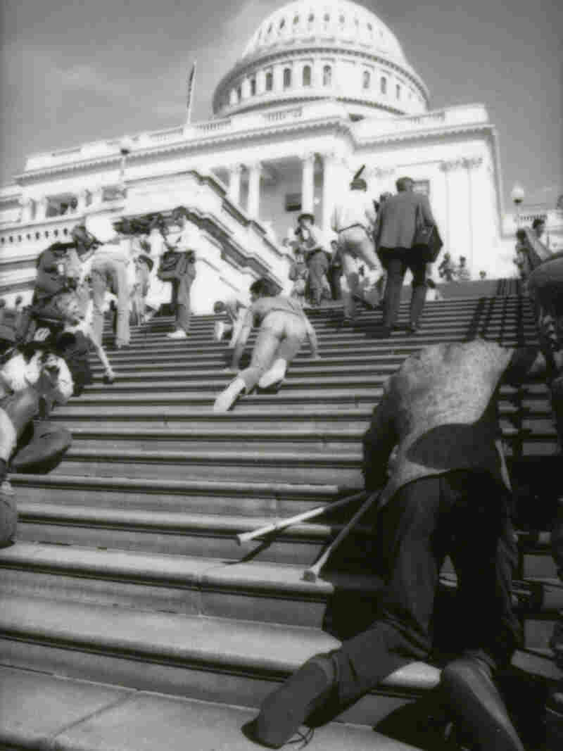 A group of people with disabilities crawl up the steps of the U.S. Capitol to draw support for the Americans with Disabilities Act, March 12th, 1990.