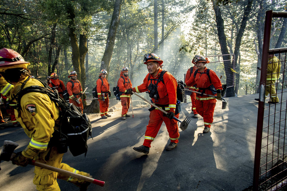 Inmate firefighters battle California's Kincade Fire on Oct. 29, 2019. In late June, officials locked down 12 inmate fire camps after outbreaks of the coronavirus within the state's prison system. (Noah Berger/AP)