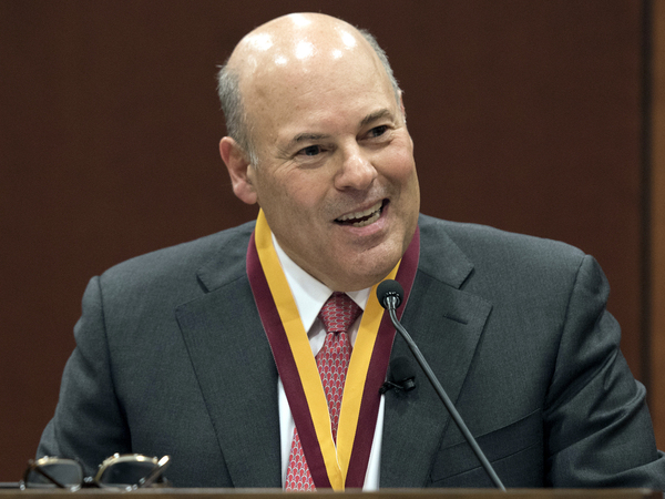 In this March 1, 2017, file photo, Elon Trustee Louis DeJoy is honored with Elon's Medal for Entrepreneurial Leadership in Elon. N.C. Now postmaster general, DeJoy's plans are controversial.