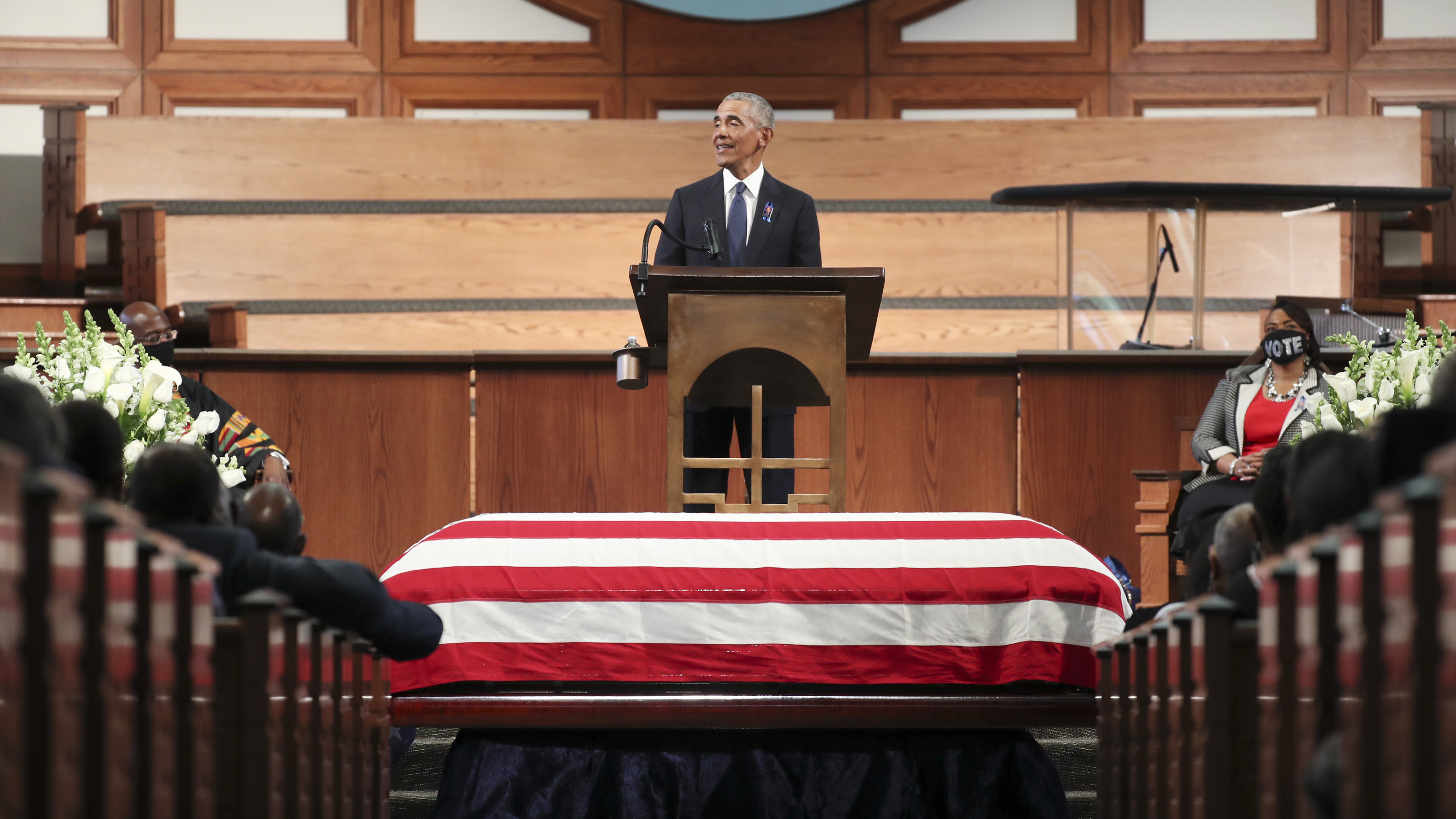 Former President Barack Obama pays tribute to the late Rep. John Lewis, D-Ga., during services Thursday at Ebenezer Baptist Church in Atlanta.