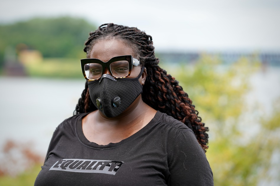 Poet and author Hannah Drake is working on a memorial dedicated to Black people whose names have been lost to history. She's shown above standing near the Ohio River in Louisville on July 23, 2020.