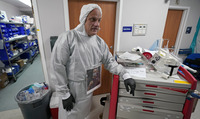 Dr. Joseph Varon leans on a medical cart inside the coronavirus unit at United Memorial Medical Center on July 6 in Houston.
